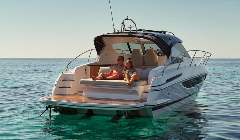 couple on yacht, sunbathing