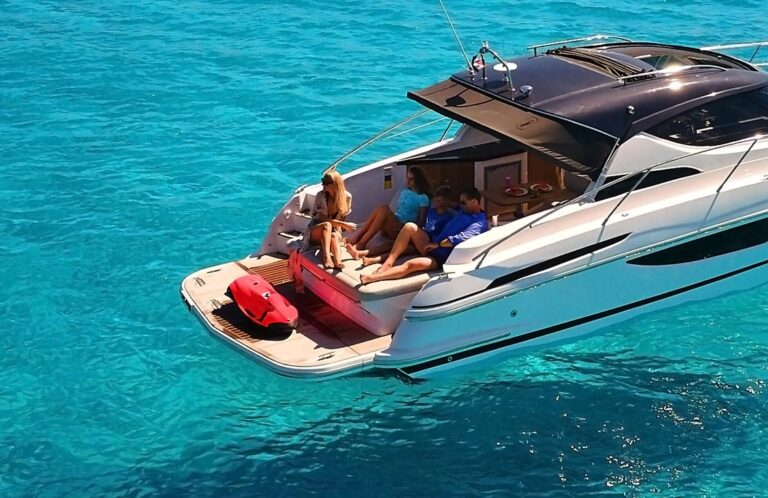 family on boat enjoying sea