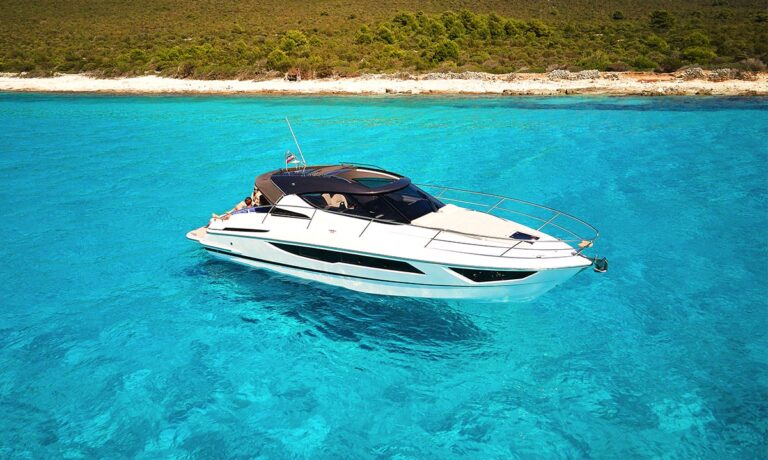 motor boat on turquoise sea water